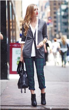 Gray cardigan, plaid pants, ankle boots.
