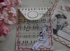 little paper pockets by littlepinkstudio, via Flickr
