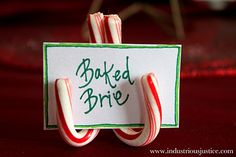 Start with two candy canes.  Glue the two candy canes together to create the label holder.  Glue on a third candy cane so the holder can stand on its own.  Add labels or place cards and ta-da!