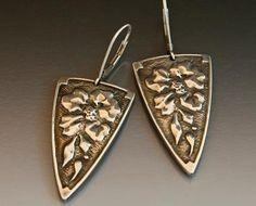 Floral motif earrings in sterling silver