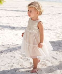 gold dust tiered dress - A girl can't help but feel like a princess. This gorgeous dress features a gold sequined bodice with tulle overlay and fluffy tulle skirt. If she feels like a princess, you might want to check out our selection of tiaras while you're at it. Made in USA.