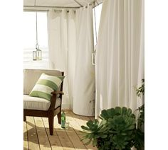 Outdoor Grommet Drape - the perfect way to get a little privacy on your apartment balcony!