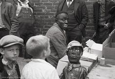 Medicine Show Performer by Ben Shahn in 1935, is an odd image of an African American man in black face preparing for a medicine show in Huntingdon, Tennessee. What a powerful and amazing photograph.