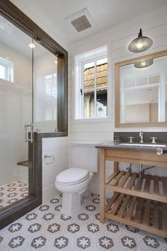 {traditional bathroom} with custom sink vanity made of rift-sawn white oak and farm-style metal light.