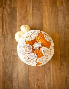 Doily Pumpkins #holidayentertaining #thanksgiving #givingthanks #november #holidays #thanksgivingideas #thanksgivingcrafts #thankful #thanks #thanksgivingrecipes www.gmichaelsalon... #diy #crafting #recipes #forthehome #holidaydecorating #holidaydecor #harvest #autumn