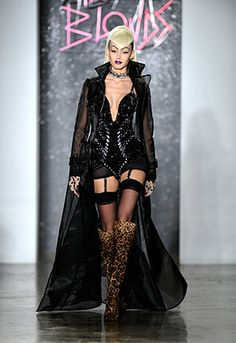 A model graces the runway in a daring corset and jacket by The Blonds at the designer's F/W 2014 #NYFW runway show.