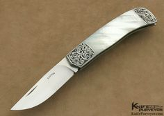 """Photo by: Michael Donato  Ron Gaston Custom Knife Engraved Mother of Pearl Slip Joint.  Blade Length: 3""""  OverallLength: 6 3/4""""  Closed Length: 3 7/8""""  Blade Steel: Hand Rubbed Satin Finished ATS-34  Scale Material: Mother of Pearl Shell  Bolster Material: Engraved 416 Stainless Steel  Locking Mechanism: Slip Joint"""