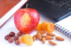 The 7 Best Foods to Keep in Your Desk at Work to Stay Satisfied All Day