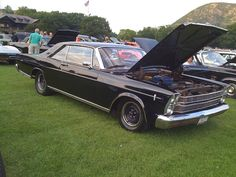 It's my 1966 Ford Galaxie 500 (well my Dads new purchase in '66).  63K,  289ci, all original.  At Bear Mountain Car Show, 9/11