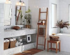 Ladder as a bathroom shelving unit. Great way to save space