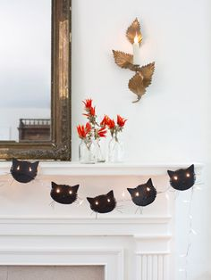 Hang this cute cat-face garland from your mantel.