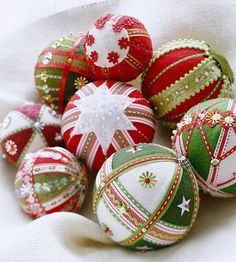 Mix and match trims, sequins, ribbon, and felt for a festive holiday ornament. More ornament ideas: http://www.bhg.com/christmas/ornaments/easy-christmas-ornaments/?socsrc=bhgpin121612embellishedornaments=21