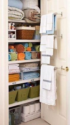 Linen Closet Organizing @ Home Improvement Ideas. This is awesome! Never thought of towel bars inside the linen closet!