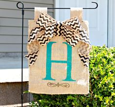 Personalized Burlap Garden Flag Yard Flag with Chevron Bow via Etsy. I just used this chevron ribbon on my wreaths.....