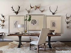 Vintage European antlers on display. Design: Betsy Brown. housebeautiful.com. #antlers #wall_art #cowhide #wall_decor