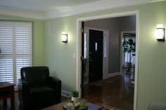 Living room and entry with custom made plantation shutters.