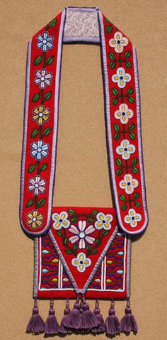 Beaded and embroidered bandolier bag: Best of Both Worlds.  Materials: Glass beads and cotton thread on wool stroud, cotton, silk. To the extent possible, all materials are authentic to the early 19th century.  - Martha Berry, Cherokee
