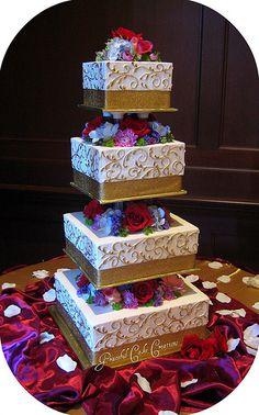 Elegant Square Ivory and Gold Wedding Cake Keywords: #goldweddings #goldweddingcakes  #inspirationandideasforgoldweddingplanning #jevel #jevelweddingplanning Follow Us: www.jevelweddingplanning.com www.pinterest.com/jevelwedding/ www.facebook.com/jevelweddingplanning/ https://plus.google.com/u/0/105109573846210973606/ www.twitter.com/jevelwedding/