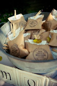 bagged favors {e photography} #weddings Very inexpensive... brown or white paper sack, clothes pin, doily and I'd add a yellow daisy.  You could stamp 'em or make labels. Out of town bag idea?! :)