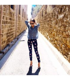 @Who What Wear - Mademoiselleecon is wearing: Stradivarius shirt, Zara pants, Ray Ban sunglasses.  Get The Look:  Armani Jeans Floral Print Skinny Jeans ($240)  See more ways to wear floral pants on Pose.com.