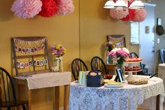 Vintage girl's first birthday party - pom poms, pennants and pinwheels via @Jessicanturner of The Mom Creative