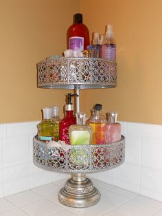 Cake stand to organize the items that clutter the bathroom counter-top..such a great idea =]