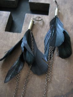Bullet casing and feather earrings