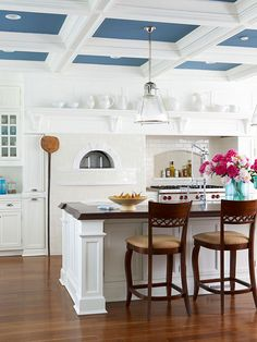 A colorful ceiling adds unexpected contrast in this classic white kitchen. More ways to add color to your kitchen: http://www.bhg.com/kitchen/color-schemes/inspiration/add-color-to-your-kitchen/?socsrc=bhgpin051113blueceiling=11