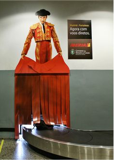 baggage carousel, Ad for Spanish airline Iberia.