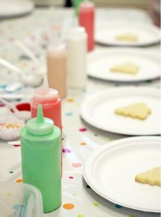 Cheap condiment bottles make decorating sugar cookies super easy, even for kids!