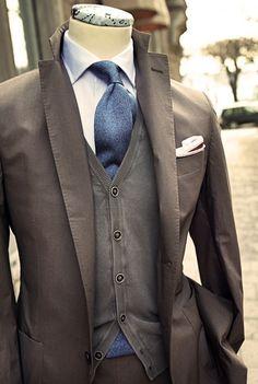 Coffee suit/cardigan. White oxford. Azure tie. White/brown pocket square. Simple, yet elegant.