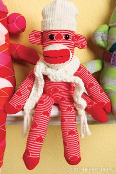 This DIY sock monkey is ready to face the cold weather with her matching hat and scarf.