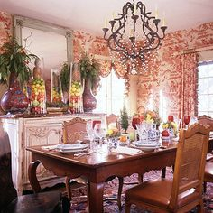 Dining Room Decor:   An opulent dining room deserves impressive holiday decorations. Commanding fruit-filled containers crown the sideboard, adding height and color to the sophisticated space. The impact is doubled in the mirror's reflection.