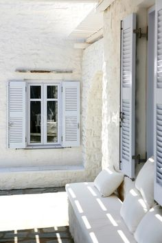 could paint the red brick and the stucco parts of the house this whitish color then do the shutters and trim in this super pale blue --- Stone + shutter color // exterior paint change
