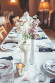 milk glass centerpieces, photo by Hazelwood Photo http://ruffledblog.com/north-star-ballroom-wedding #weddingideas #tablescapes #milkglass