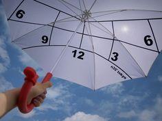 time-telling, sun-protecting umbrella