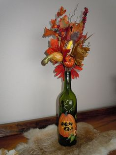 Hand painted wine bottle with motif of fall by AKKUniqueGifts, $55.00