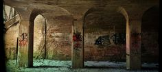 Winter still hides under shade inside the belly of the trestle  Frankfort train bridge by Catherine