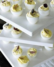 Dirty Deviled Eggs with creme fresh, mustard and olives