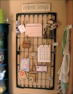Upcycled Crib Spring. Yes, it's the part that the baby mattress sits upon! Makes a great display board, doesn't it?