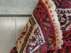 How to hang a rug on a wall.