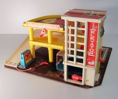 Not decor...but want to find one of these anyway! SALE Fisher price garage toy vintage 1970 toy