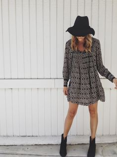 Love the long-sleeve short dress with the floppy hat combination.
