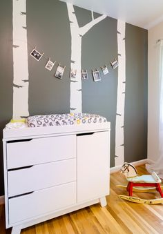 Modern Nursery with Tree Accents