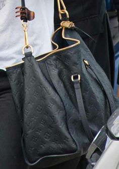 Louis Vuitton Leather Tote... Lol with the clip pie attached of course!