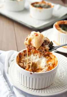 Personalized size ramekins filled with homemade pasta noodles, spicy Italian sausage, fresh-made tomato sauce and cheese – lots and lots of ...