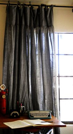 grey linen curtains - might be too dark for our house, but love the design