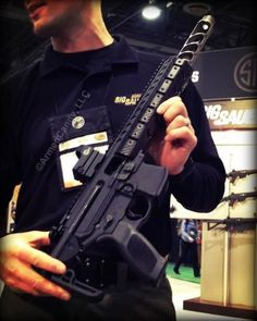 Meet the new Sig Sauer MPX sub-machine gun. SHOTShow 2013 Brilliant design!