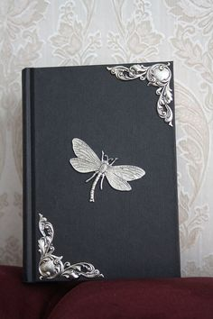 Decorated notebook - gothic victorian silverplated dragonfly and silverplated hook embellishments via Etsy