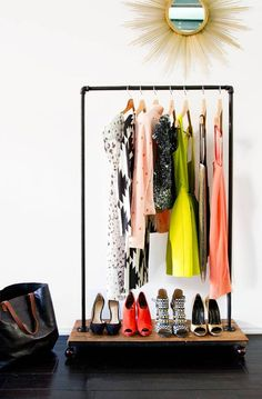nothing better than a hanging rack full of gorgeous clothes {and cute shoes too!} #decor #deco #decoration #organization #homedecor #homeorganization #livingroom #homedecoration #livingroom #house  #interiordesign #organization #room